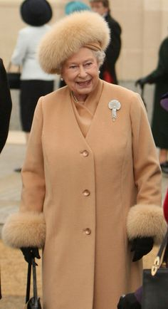 The Queen in soft colors. This  suits her better than vivid colors she wears usually... to be seen among the crowd!