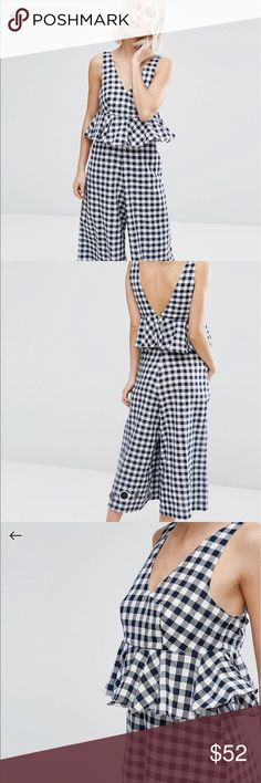 ASOS gingham jumpsuit by Lost Inc. US size 2. Gingham jumpsuit with ruffle peplum. Length hits mid calf. Zipper back. V-Neck. Linen fabric mix. Wife cute leg. Brand new with tags!! Asos Pants Jumpsuits & Rompers