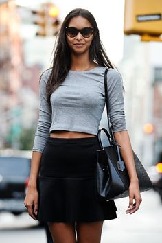 Shop this look for $57:  http://lookastic.com/women/looks/grey-cropped-sweater-and-dark-brown-sunglasses-and-black-tote-bag-and-black-a-line-skirt/3552  — Grey Cropped Sweater  — Dark Brown Sunglasses  — Black Leather Tote Bag  — Black A-Line Skirt