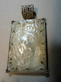 Sterling and carved mother of pearl pendant
