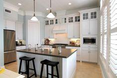 kitchen // white cabinets, dark counters, pale blue-grey walls