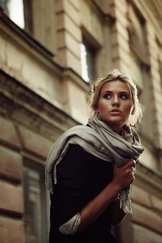 I like the fact that she is not holding a coffee cup!!! Just showing the scarf.