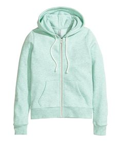 Cozy up in this soft mint green sweatshirt with drawstring hood, pockets, and brushed inside. | H&M Pastels