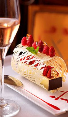 White chocolate and raspberry dessert - It looks like it's in an elegant cage or something, but it's amazing.