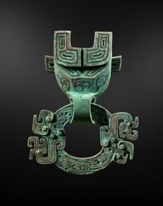 Bronze Taotie mask and ring China Spring and Autumn period (770 - 481 BC) Bronze with green and brown patina Ht 20 cm (8 in.)