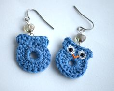 Crochet owl earrings made from embroidery thread, little black seed beads for eyes and with a little grey heart shaped glass bead. They are very