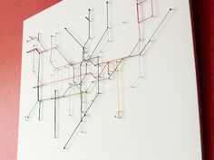 Underground London map made with strings. See video here http://vimeo.com/fsmvpggru/stringmap
