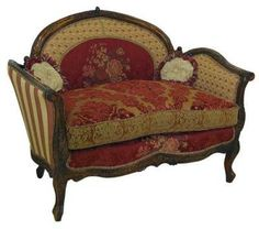 """""""Brandy Chair"""" from the """"Victorian Trading Company"""" ... this comfy perch offers guiltless elegance...a pint of ice cream and a bestseller are welcome here!  Rich brocade with intricately carved details.  Kiln-dried hardwood frame.  Hand-tied coils.  Cushions are a featherblend fill"""