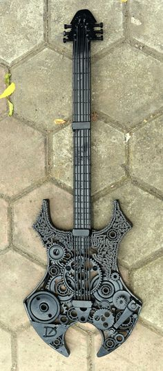 Metal scrap virgo guitar sculpture                                                                                                                                                                                 More