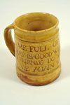"Mug White slip with sgraffitoed script Dimensions: H 13cm x W 10.5cm  Artist: Michael Cardew  Date: 1926-39  Company: Winchcombe Pottery  Notes: Inscibed ""FILL ME FULL OF LIQUOR . .""  www.burtonartgallery.co.uk"