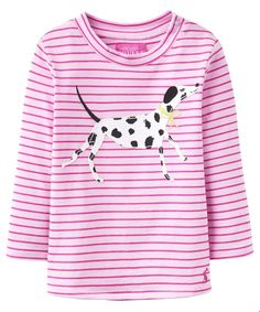 The Girl's Joules Toddler Ava Top is a fun and fabulous top for your little one this season. Made from 100% soft cotton for added comfort and ease of movement, the Joules Ava Top is available in a range of quirky styles and designs that will really show of your little girl's personality. With a simple round neck and long sleeves this Joules jersey top is a beautifully comfy little top that she will love to wear again and again. For ages sized 6-12m please see the <a href=&quo...