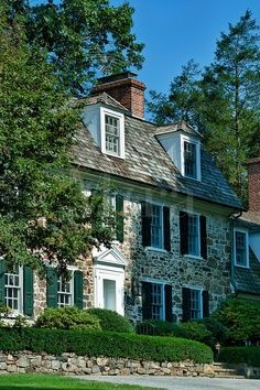 Stone home with green #Shutters. frenchshutters.com