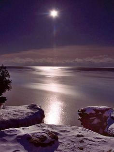 Moonrise at Cave Point ~ snow covered cliffs, Cave Point, Door County, Wisconsin by James Jordan