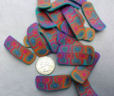 Bright Orange Fuchsia and Turquoise Polymer Clay by crystalsoflove, $1.50 per bead.  Discount offered on lot.