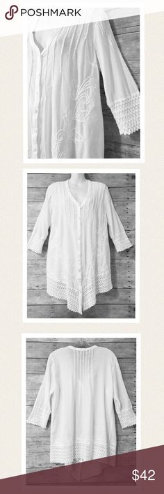 """SALE Peruvian cotton tunic 100% Peruvian cotton, V-neck with button down front and 3/4 sleeves. Exquisite crocheted trim on sleeves and hem with embroidered design and pin tuck pleats in front & back. Retails for$105. Worn only a couple of times, still in very good condition. The only flaw is two very tiny rust looking spots, one at edge of hem, one near button, not noticeable when wearing, see photo #4. bust 21"""" armpit to armpit length 33"""" from center of neck to hem size says small but…"""