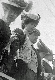 Consuelo Vanderbilt (1877-1964), was the daughter of a prominant New York railroad millionaire and later became Duchess of Marlborough.  In the photo, Consuelo (C), is seen in a front row grandstand seat for the 1905 Vanderbilt Cup Race.