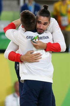 Silver medalist Louis Smith of Great Britain hugs gold medalist Max Whitlock of…