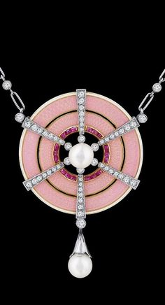 An Art Deco platinum, gold, enamel, diamond and pearl pendant. On a chain set with single cut diamonds. #ArtDeco