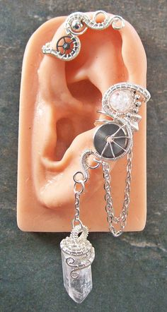 Bright Silver Crystal Steampunk Ear Cuff/Wrap (Choose Stone). $34.99, via Etsy.