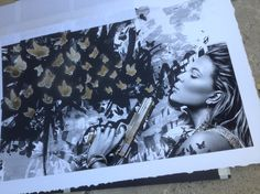 """Letting the paint dry after using stencils and spray paint on this """"Kamp Monarch"""" print.  This is a limited edition Artist Print by Kamp Collective."""