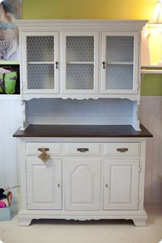 Transformed Hutch - chicken wire instead of glass, and white paint with dark stained wood for the surface area