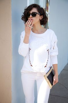white on white: Wearing a Zara sweatshirt, J Brand jeans, vintage jewelry, Jimmy Choo pumps, Ray-Ban sunglasses, and Balenciaga clutch.