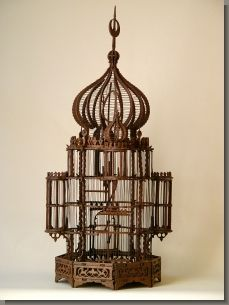 An Orientaliste natural wood birdcage