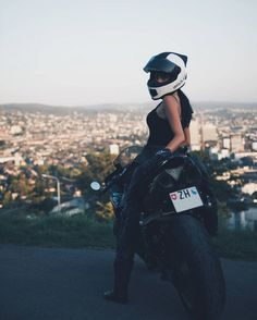 Biker Girl With Skully Motorcycle Helmet on