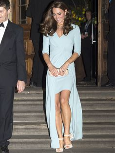 Kate Middleton in a light blue wrap dress and matching cream-colored accessories