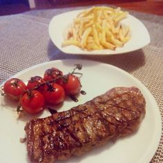 Sirloin with grilled cherry tomatoes.