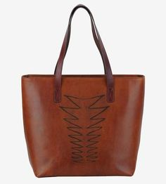 Finished with a zippy zigzag design, this leather tote bag fits everything you need for work or play. The spacious interior is fully lined, and even fits a laptop, making it a top choice for commuting or carrying on. Interior pockets hold small items, such as sunglasses or your precious cell phone, and a top zipper keeps everything secure.