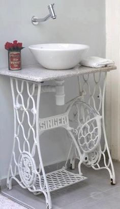 Old metal sewing machine base, painted white repurposed into sink vanity; Upcycle, Recycle, Salvage, diy, thrift, flea, repurpose!  For vintage ideas and goods shop at Estate ReSale & ReDesign, Bonita Springs, FL