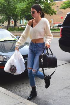Kendall Jenner wearing Citizens of Humanity Liya Jeans in Torn, Ray-Ban Rb2447 Round Metal Sunglasses, Givenchy Leather Weekend Bag, Louis Vuitton Republic Ankle Boot and Givenchy Lucrezia Micro Bag in Star Embossed Leather