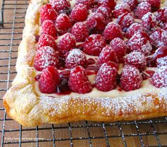 I like this concept but would probably change the recipe a lot -- somehow leave out the cheesecake part. And make homemade pastry. But I like the idea of a very rustic fruit dessert like this.