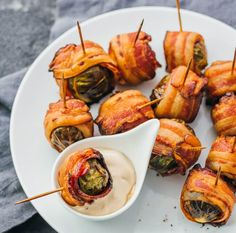 Here's the easiest and best recipe on bacon wrapped brussels sprouts! This amazing Thanksgiving side dish has a balsamic vinegar mayo dip.