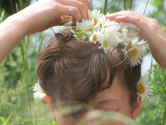 zero-one of the leaders at outdoor school, she made daisy chains with everyone