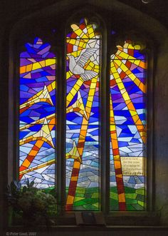 trumpets being blown and the Holy Spirit descending. | Stained Glass Windows at St. Mary's Church, Potton, Bedfordshire.