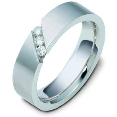 14K white gold comfort fit, 6.0 mm wide, diamond ring. Diamond weighs 0.15 ct tw and graded as VS1 in Clarity G in Color. The finish on the ring is brushed. Different finishes may be selected or specified.