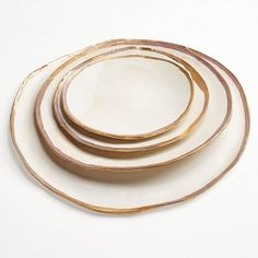 Jan Burtz Gold Luster Plates Exclusively at ABC, these plates are touched by a delicate gold border that lovingly outlines their natural and irregular forms.