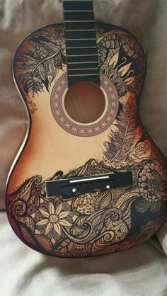 Sharpie art on an old broken guitar i found in the trash. One man's trash is another women's treasure ;)