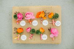colorful ranunculus boutineers | photos by Apryl Ann | 100 Layer Cake