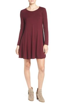 Picturing this flowy long sleeve dress with an adorable floppy hat and a pair of booties.