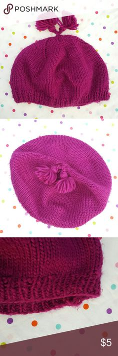 Soft Beret Fuchsia.  Has 2 little pom poms on top.  This is not a beanie.  I usually wear it about an inch behind my hair line. It then hangs loosely in the back. Accessories Hats