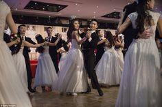 The ballroom at the Kempinski saw the debutantes whisked around the dancefloor clutching w...