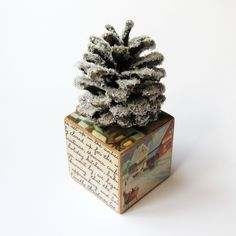 Rustic Christmas Tree- Primitive Glittered Pine Cone on a Wooden Block. $22.00, via Etsy.