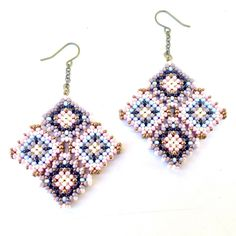 TSOul (Navajo) experiments with beadwork techniques to create some very special pieces like these earrings that feature a 3D diamond pattern. So pretty.
