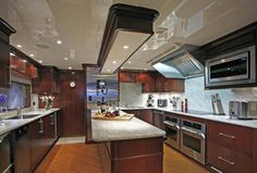 The kitchen of a luxury yacht...into which I could put my kitchen and the entire first floor of my house. (And you wondered why my pallor was a tad green this morning.)