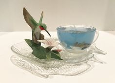 Lavender Scented Seascape Gel Candle in Glass Cup Resting on Unique Fish Plate Porcelain Hummingbird Gel Candles, Glass Tea Cups, Fish Plate, Lavender Scent, Sea Shells, Clear Glass, Porcelain, Plates, Hummingbird