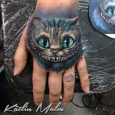 Cheshire Cat Hand Tattoo