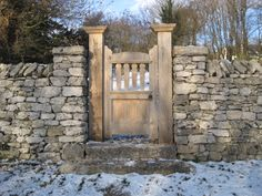 Limestone wall with pillars and oak gate, Cumbria. Built by dry stone waller Andrew Loudon.